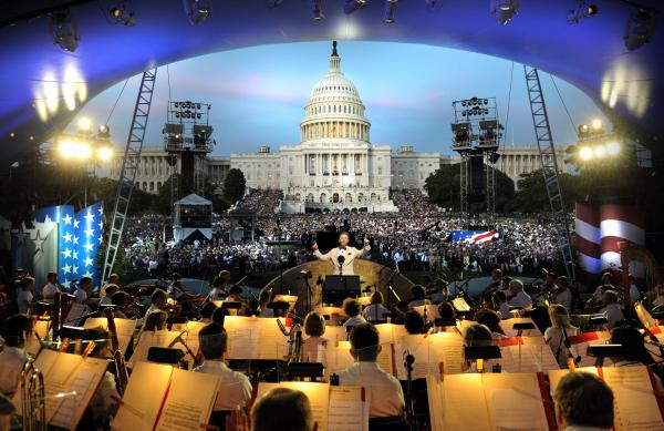 National Memorial Day Concert 2014 conductor Jack Everly leads the National Symphony Orchestra before a crowd of thousands on the West Lawn of the U.S. Capitol.