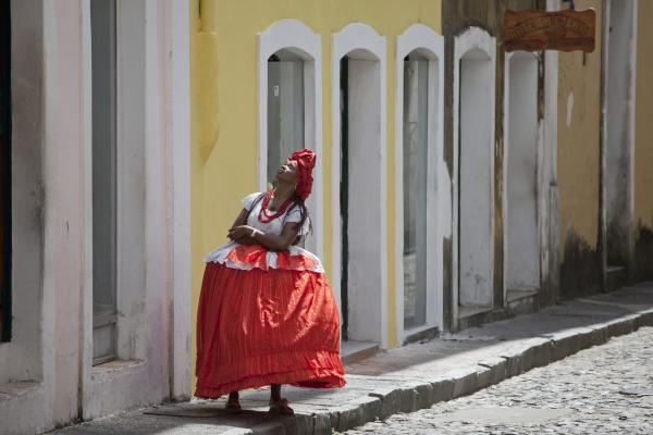 On the streets Salvador, the largest African city outside Africa, the women wear big smiles and even bigger Bahian dresses.