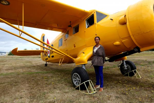 Detective Kaiama Glover in front of a Norseman bush plane, the same kind Glenn Miller boarded before his mysterious disappearance. Can this plane unlock the secret of what happened to him?