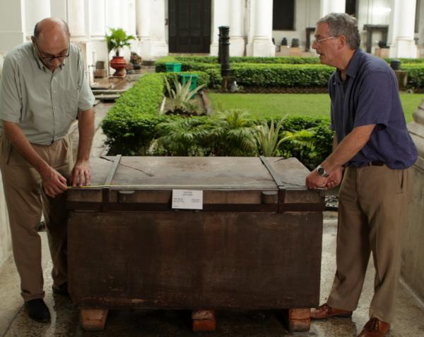 At Calcutta's Indian Museum, German scholar Professor Harry Falk (left) and author Charles Allen examine the stone chest that contained the original Piprahwa find.