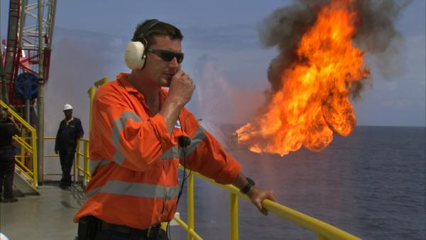 Oil worker at a well test in Ghana, about 60 kilometers off shore.