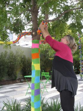 Ronda Van Dyk and the Dallas Yarn Bombers are adding colorful 'coats' to Chinese Pistache trees in Dallas' new Klyde Warren Park