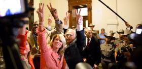 Sen. Wendy Davis holds up two fingers, urging senators in June to vote against the abortion bill.