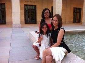 New citizen Phong Nguyen, her niece Lily and young daughter Jackie before the ceremony at the Bush Presidential Center.