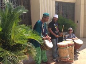 Three musicians playing West African drums greeted the crowd at Nelson Mandela's birthday party.
