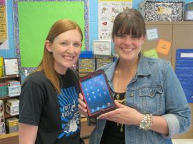 Teacher Sarah Claborn and Principal Angela Vaughan show-off the  new iPad Mini available to each student this year at the Math Science  Technology Magnet.