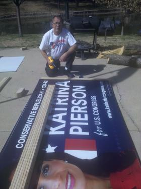 Ladd Stauffer of Garland assembles yard signs for tea party candidate Katrina Pierson who is running against Republican Rep. Pete Sessions of Dallas.