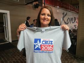 Morgan McConk holds shirt backing a Ted Cruz presidential run.