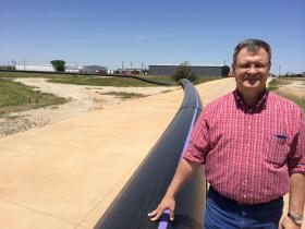 Utilities Operations Manager Daniel Nix stands next to the 13-mile pipeline that will transport treated wastewater to the city plant. There, the water will be purified for drinking.