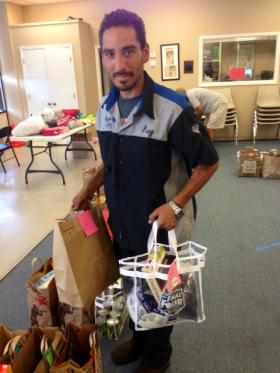 Rey Gonzalez takes advantage of the food pantry near his home in Lake Highlands. He also volunteers there.