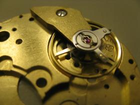 Properly placing the hair spring, under the jewel, is among a watch maker's toughest tasks.