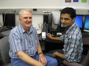 Cochlear implant patiet John Ayers and UTD Research Assistant Hussnain Ali test smartphone technology.