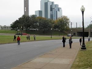 Tourists at site where President Kennedy was shot 48 years ago.