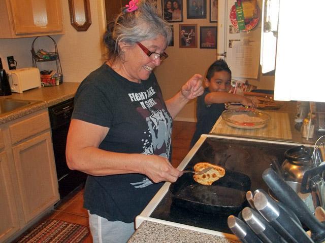 Koni Ramos Kaiwi making bunuelos.
