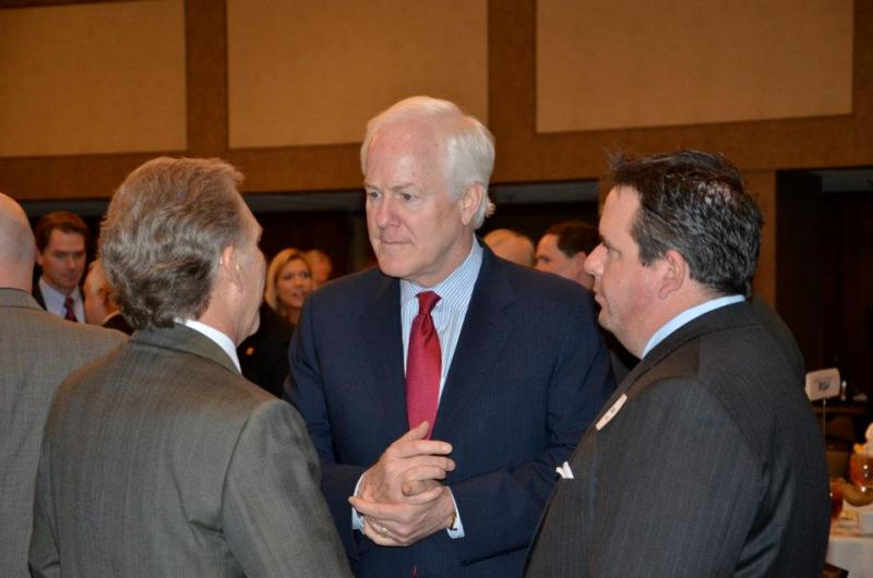 Texas Senator John Cornyn in red tie