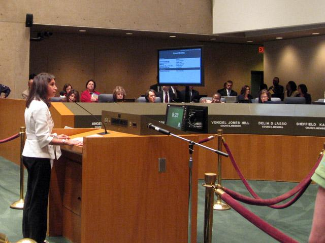 Yasmin Bhatia, CEO, Uplift Education, standing before the Dallas City Council.