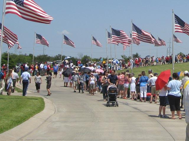 Crowd attending services at DFW's National Cemetery.