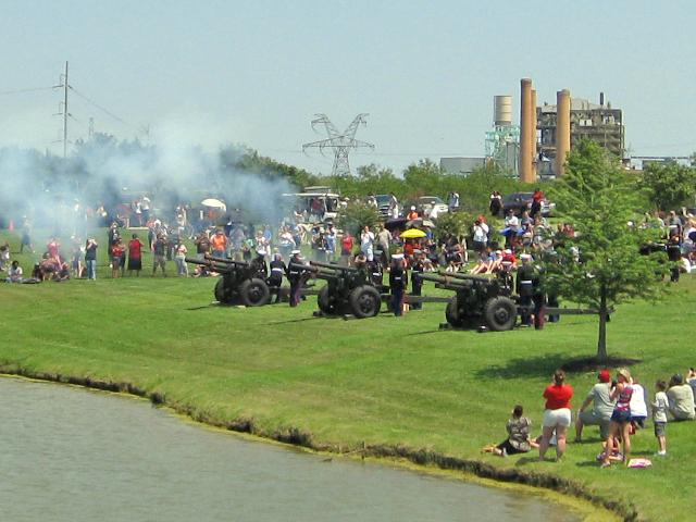 Cannon in distance, during 21-gun salute.