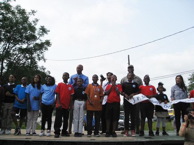 Neighborhood advocates and children cheered the demolishing of the house.