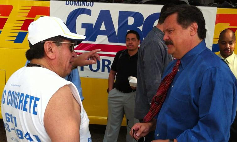 Domingo Garcia, right, speaks with supporters.