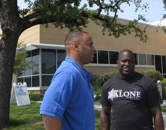 Marc Veasey, left, talks with a supporter.