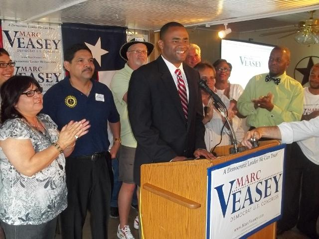 Marc Veasey arrives at his watch party around 8 p.m. He's ahead of Domingo Garcia at this point.
