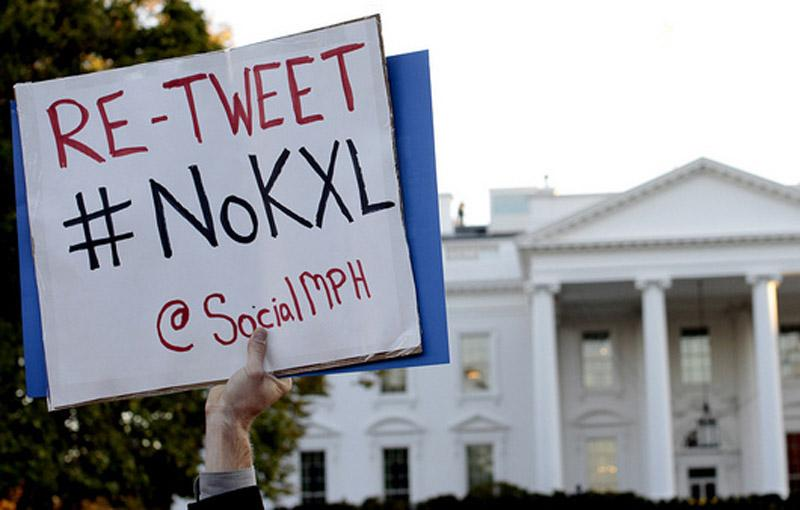 A citizen protests the Keystone XL Pipeline at the White House last year.