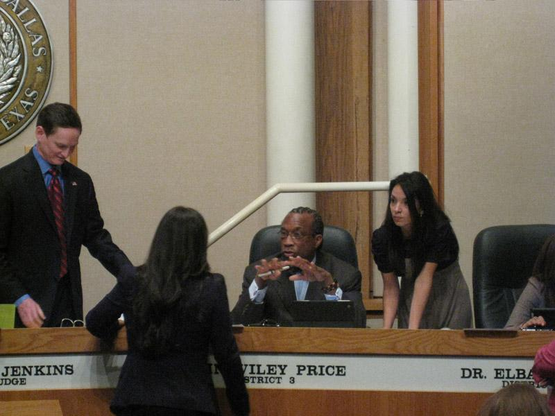 Judge Clay Jenkins, far left, stands during a break at Tuesday's meeting of the Dallas County Commissioners Court with Commissioner John Wiley Price, center.