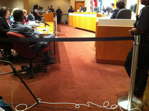 A barrier prohibits press from accessing the Dallas County Commissioners this week as John Wiley Price makes his first public appearance after details of the allegations against him were released.