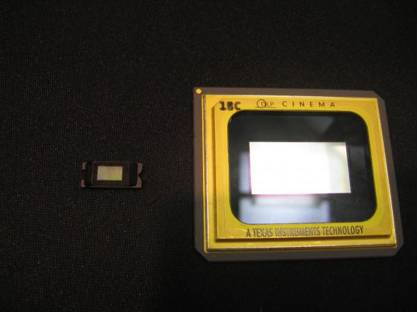 Large chip is used in projecting films in a movie house screen. Small chip goes in your smart phone and does basically the same thing.