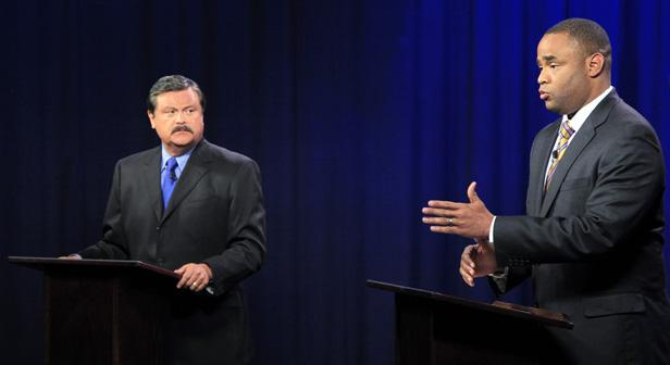 Domingo Garcia, left, and Marc Veasey square off in a debate at KERA studios Tuesday.