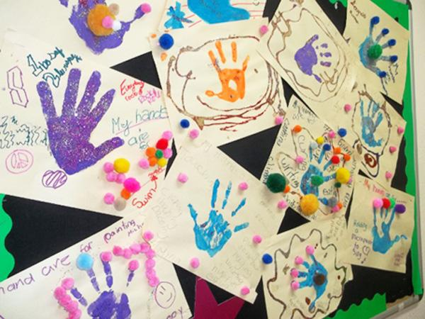 Children at Safe Haven's Fort Worth Shelter give examples of things they can use their hands for besides hitting: swimming, painting; holding a microphone to sing.