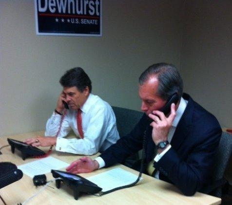 Governor Rick Perry, left, makes a call on behalf of Lt. Gov. David Dewhurst, who's running for Senate in the runoff election Tuesday.