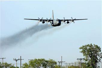 A C-130 Hercules in Ohio, performs a mosquito control aerial spray mission May 25, 2011, over Grand Forks Air Force Base, N.D.