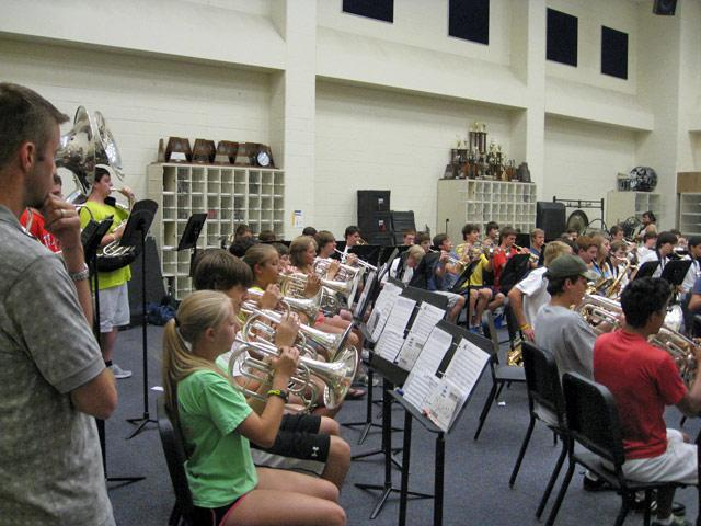 Highland Park High School band with Reagan Brumley looking on.