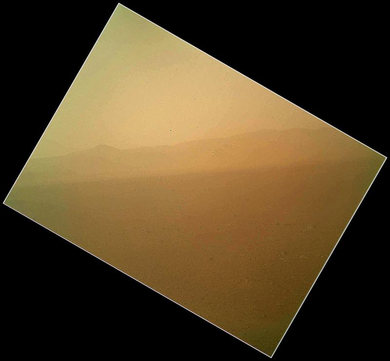 This first color image of the landscape to the north of NASA's Mars rover Curiosity was acquired by the Mars Hand Lens Imager (MAHLI) on the afternoon of the first day after landing.