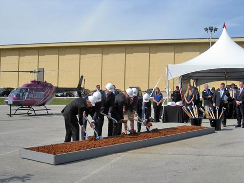 "Federal, state and local officials ""officially"" breaking ground of new Bell headquarters."