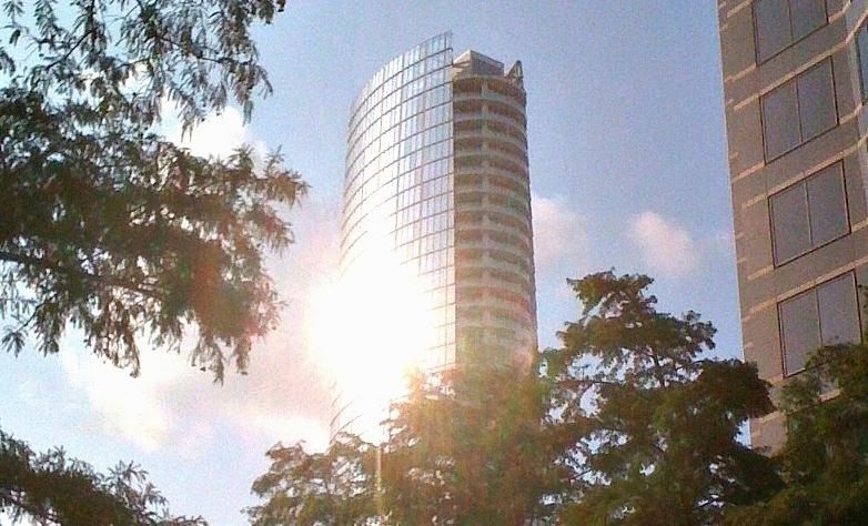 The glare from Museum Tower is clear in this view from the Nasher Sculpture Center's garden.