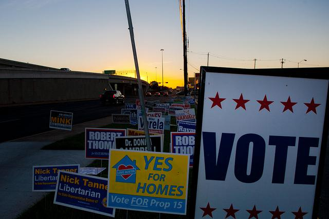The sun rises over a river of political signs in Austin on Tuesday morning.
