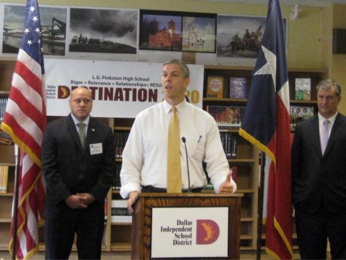 Adam Medrano (left), Secretary Duncan at the microphone, Mayor Mike Rawlings (right)