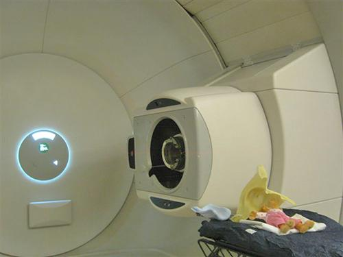 The proton beam travels through this aperture. (In the corner is a doll left by a child after treatment.)
