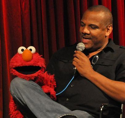 Kevin Clash appears with Elmo, whom he voices, on 'Employee of the Month'last year. It's a talk show about dream jobs.