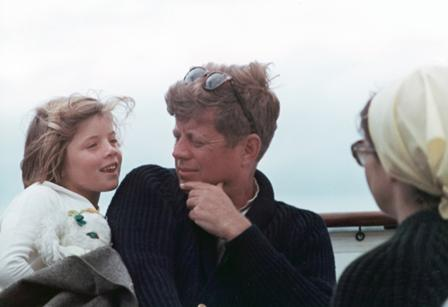 John F. Kennedy, his daughter Caroline and his wife Jackie aboard the family boat, Honey Fitz, off Hyannis Port, Mass.
