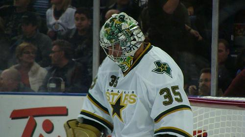 Former Dallas Stars goaltender Marty Turco hangs his head during his last leg with the team.