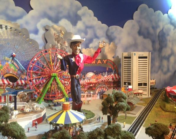 The Dallas portion of North Park Center's train exhibit this year features Big Tex standing in the center of Fair Park, unscathed.