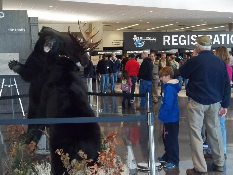 Conventiongoers check out a bearfight at the entrance.