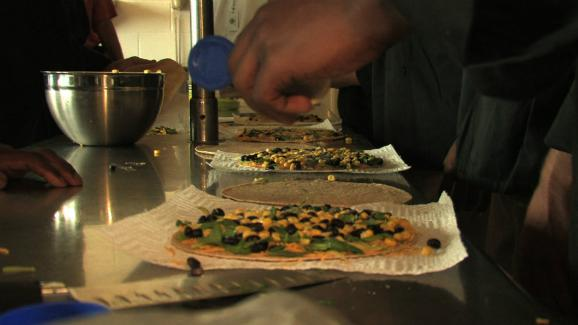 Students in the culinary program at the Dallas Youth Village prepare vegetable quesadillas.