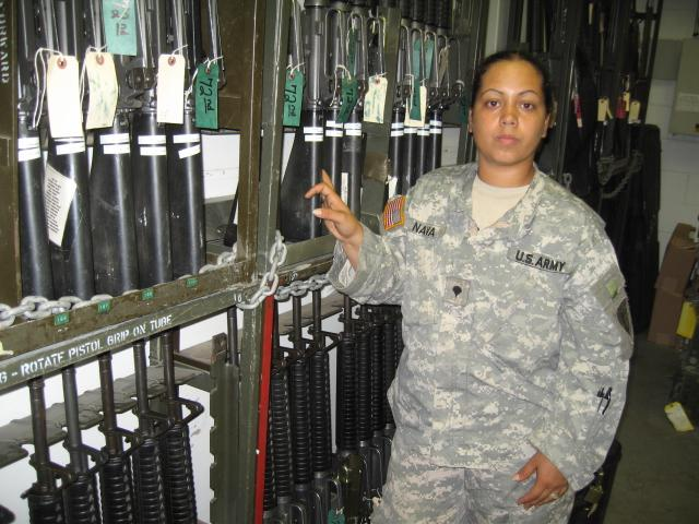 Spc. Rebecca Nava stands in the arms room at Fort Riley, Kansas. Nava was an Army supply clerk who fought in Iraq.