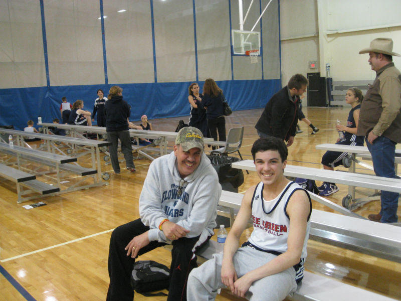 Ricky Rijos Jr. relaxes after basketball practice with his dad, Riki Sr.