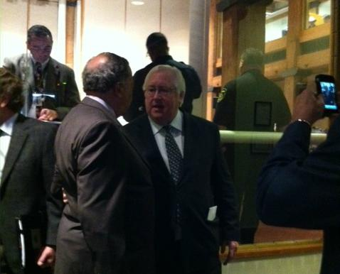 Dr. Ron Anderson talks with friends after Dallas County Commissioners honored his years of service with a resolution.